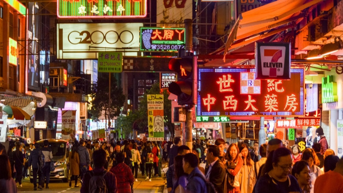 Hong Kong street scene with neon signs at night