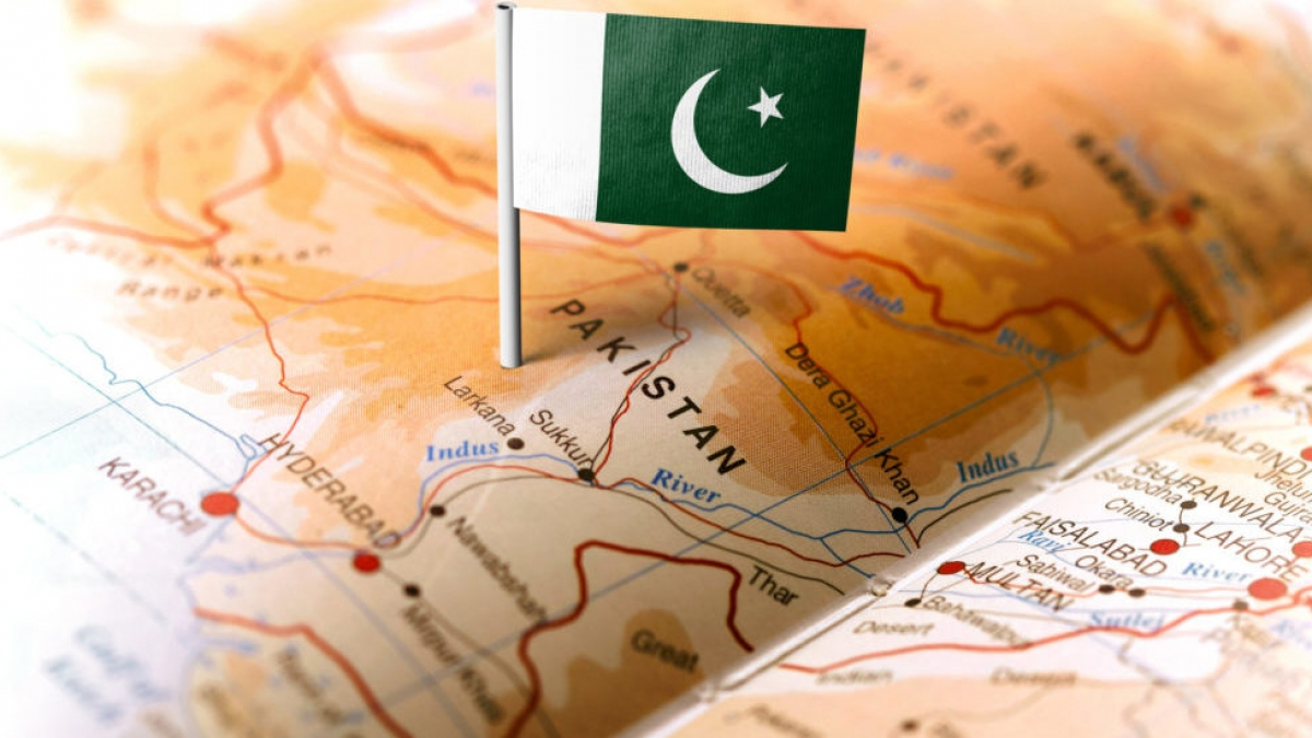 The flag of Pakistan pinned on the map. Horizontal orientation. Macro photography.